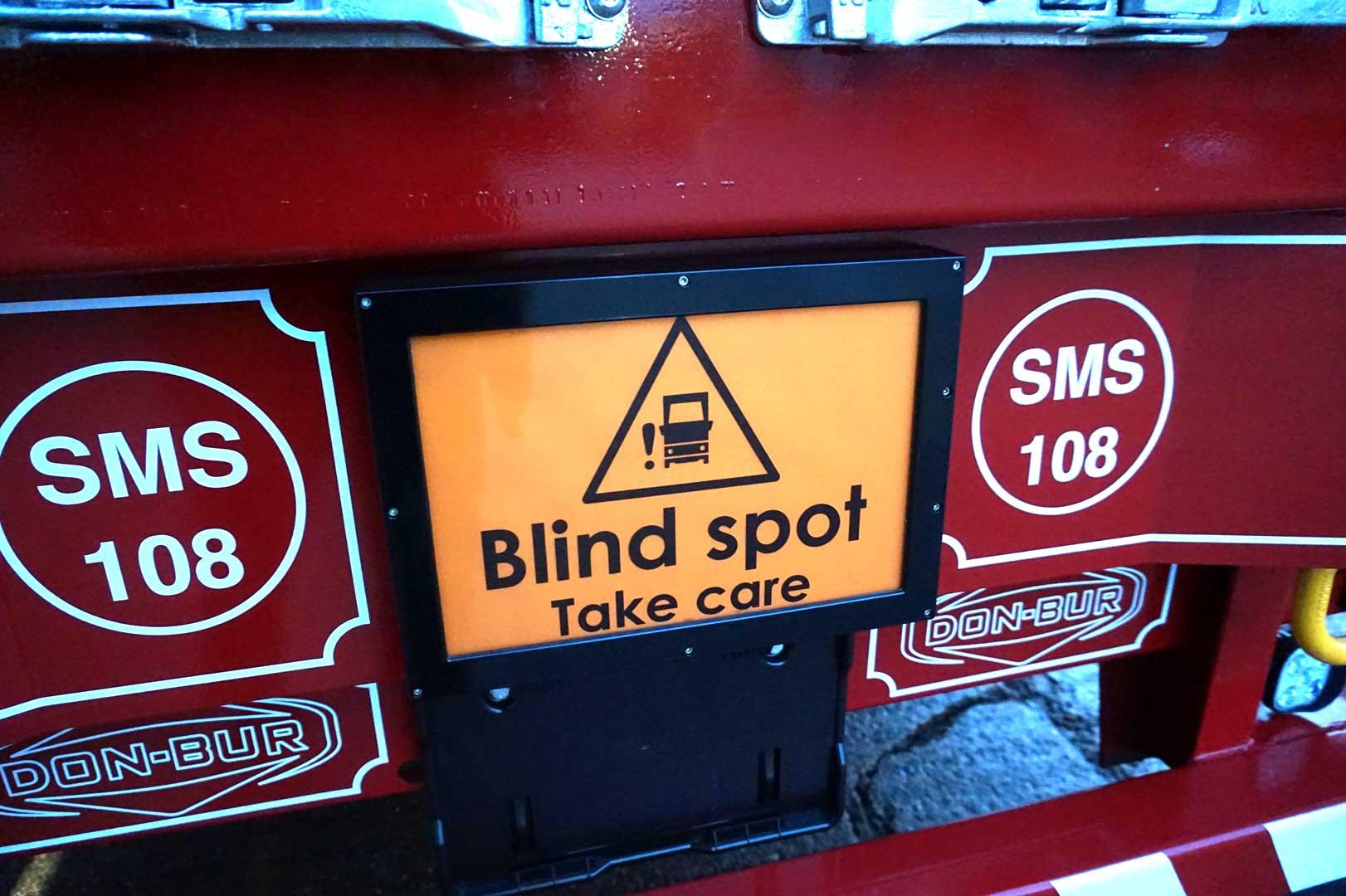Flashing Rear Blind Spot Sign